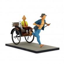 Tintin and Snowy in a rickshaw