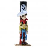 Figurine Pixi Origine Lucky Luke attaché au poteau de torture